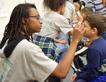 2018 Family Reading Night: Face painting by Information Resource Center